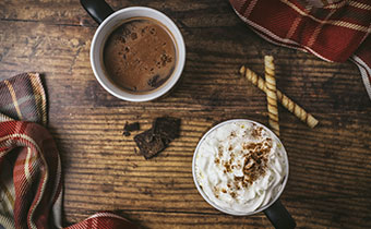 overhead photo of 2 cups of coffee on a table, Photo by Rinck Content Studio on Unsplash
